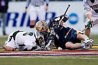 John Schiavone (39) of Loyola loses the face-off to Trever Sipperly (7) of Notre Dame during the Face-Off Classic in at M&T Stadium in Baltimore, MD