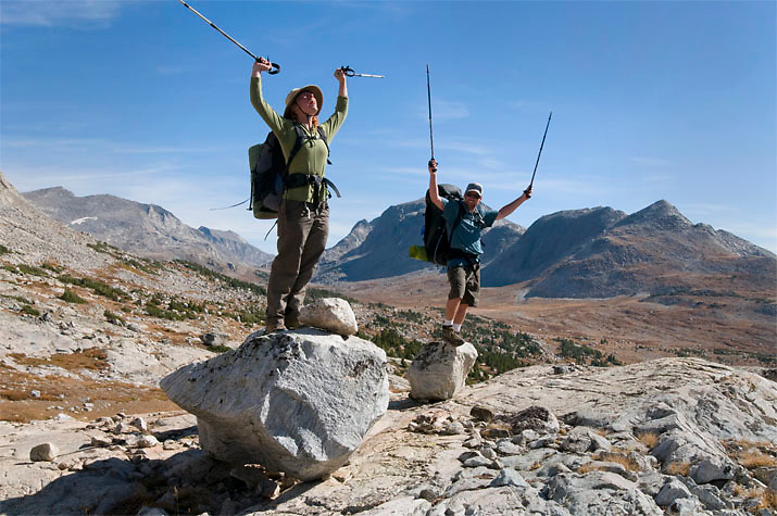 A pair of hikers shouts in revelry. Wind River Range, WY