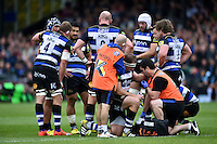 Henry Thomas of Bath Rugby is seen to by physios during a break in play. Aviva Premiership match, between Bath Rugby and Exeter Chiefs on October 17, 2015 at the Recreation Ground in Bath, England. Photo by: Patrick Khachfe / Onside Images