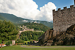 A view of all three castles, with Castelgrande castle wall in the foreground, in Bellinzona, Switzerland