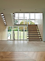 A wide cantilevered staircase winds up between the different floors of the house