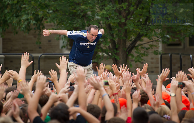 Sept. 7, 2011; Men's Basketball head coach Mike Brey dives into the student section at the Pep Rally before the first home football game 2012...Photo by Matt Cashore/University of Notre Dame