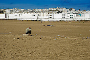 Young Moroccan fugitives sleep on the beach in Tanger after unsuccessful night attempt to cross the port's checkings, Morocco, 23 October 2006. Every day tens of Moroccan young men try to cross ilegally the Strait of Gibraltar. ?Harraga? (immigrants in Arabic) come to Tanger from all over Morocco. They try their good luck and hidden between the wheels of a truck they attempt to board on a ferry and get to Spain, eventually further to Europe. Considering the thorough checks at the port only few of them make it. Therefore they spend months living on a beach, in huts along the walls of the port, begging for food and waiting for the right night so as their dream about Europe came true.