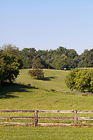 Rolling farmland enclosed by split-rail fences, Potomac, Maryland.