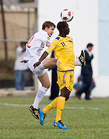 Samuel Piette (2) of Canda fights for the ball with Jabarry Chandler (11) of Barbados during the group stage of the CONCACAF Men's Under 17 Championship at Jarrett Park in Montego Bay, Jamaica. Costa Rica defeated El Salvador, 3-2.