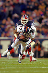 17 December 2005: Denver Broncos wide receiver Rod Smith (80) is tackled by safety Troy Vincent (23) of the Buffalo Bills at Ralph Wilson Stadium in Orchard Park, NY. The Broncos defeated the Bills 28-17. .Mandatory Photo Credit: Ed Wolfstein