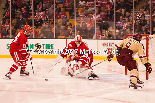 Dante Fabbro (BU - 17), Jake Oettinger (BU - 29), Austin Cangelosi (BC - 9) - The Boston University Terriers defeated the Boston College Eagles 3-1 in their opening Beanpot game on Monday, February 6, 2017, at TD Garden in Boston, Massachusetts.
