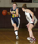 TORRINGTON, CT, 01/04/08- 010408BZ05- Kennedy's Amber Alberto (23) drives past Torrington's Lindsey Begay (32) during their game at Torrington High School Friday night.<br /> Jamison C. Bazinet Republican-American