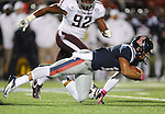 Mississippi quarterback Barry Brunetti (11) dives against Texas A&amp;M defensive lineman Jonathan Mathis (92) in Oxford, Miss. on Saturday, October 6, 2012. (AP Photo/Oxford Eagle, Bruce Newman)..