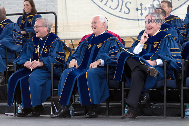 May 21, 2017; University of Notre Dame President Rev. John I. Jenkins, C.S.C. Vice President Mike Pence and Notre Dame Board of Trustees chairman Jack Brennan laugh during Commencement 2017. (Photo by Matt Cashore/University of Notre Dame)