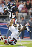 Mississippi's Jesse Grandy (10) is tackled by Fresno State's Desia Dunn (24) on a kickoff return during an NCAA college football game at Vaught-Hemingway Stadium in Oxford, Miss. on Saturday, Sept. 25, 2010. (AP Photo/Oxford Eagle, Bruce Newman)  ** MAGS OUT, NO SALES, MANDATORY CREDIT **