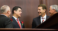 TALLAHASSEE, FLA. 3/3/15-Speaker Pro Tempore Rep. Matt Hudson, R-Naples, left, House Speaker Steve Crisafulli, R-Merritt Island, Senate President Andy Gardiner, R-Orlando, and Senate President Pro Tempore Garrett Richter, R-Naples, right, talk during a lull in the opening day of the 2015 Legislative Session, Tuesday at the Capitol in Tallahassee.<br /> <br /> COLIN HACKLEY PHOTO