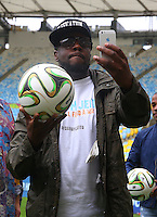 Artist Wyclef Jean takes a selfie on the Maracana pitch ahead of tomorrow's FIFA World Cup final Germany vs Argentina where he will perform during the closing ceremony