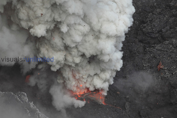 Violently erupting vent of Dukono Volcano degassing and ejecting volcanic bombs, Halmahera, Indonesia