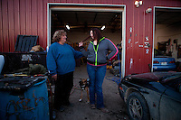 """Shelia Burnett, left, and her daughter Lauren Burnett joke around in front of Boggs Auto Salvage and Sales in Franklin, Mo. """"I don't know why I'm going through this other than making my daughter a stronger person,"""" Burnett said."""