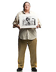 Dick Waterman, holding a photo of Bob Dylan that he shot at the Newport Folk Festival in 1965, in Oxford, Miss. on Tuesday, August 30, 2011.