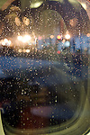 with raindrops covered passenger airplane window