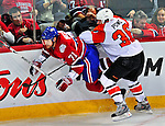 18 December 2008: Philadelphia Flyers' left wing forward Darroll Powe checks Montreal Canadiens defenseman Patrice Brisebois in the second period at the Bell Centre in Montreal, Quebec, Canada. The Canadiens look to avoid a four-game slide, while the Flyers seek their sixth win in a row. The Canadiens defeated the Flyers 5-2. ***** Editorial Sales Only ***** Mandatory Photo Credit: Ed Wolfstein Photo
