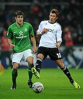 FUSSBALL   1. BUNDESLIGA   SAISON 2011/2012    16. SPIELTAG SV Werder Bremen - VfL Wolfsburg          10.12.2011 Sokratis Papastathopoulos (li, SV Werder Bremen)  gegen Mario Mandzukic (re, VfL Wolfsburg)