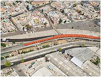 Aerial shot of Mexico City's metro or subway snakes through the urban sprawl.