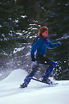 Woman running in snowshoes at Castle Peak