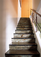 The simplicity of this steep, straight staircase adds impact to a small apartment