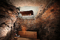 An opening leading to a wherehouse through a drug tunnel found in Otay Mesa, California.  The tunnel, which led from the United States to a small business building in Tijuana, was the most sophisticated tunnel ever found in California and inluded an elevator, wood flooring an lighting .(Photo by Sandy huffaker/Getty Images)