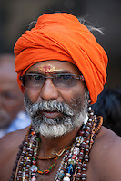 Hindu sadhu pilgrim with beads and turban in holy city of Varanasi, Benares, India