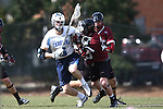 14 February 2015: North Carolina's Jake Matthai (6) and UMass's Nick Mariano (right). The University of North Carolina Tar Heels hosted the University of Massachusetts Minutemen in a 2015 NCAA Division I Men's Lacrosse match. UNC won the game 20-8.