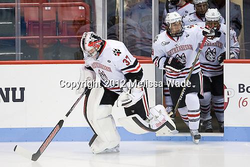 Chris Rawlings (NU - 37), Garrett Vermeersch (NU - 9) - The Northeastern University Huskies defeated the visiting Merrimack College Warriors 4-2 (EN) on Wednesday, October 10, 2012, at Matthews Arena in Boston, Massachusetts.