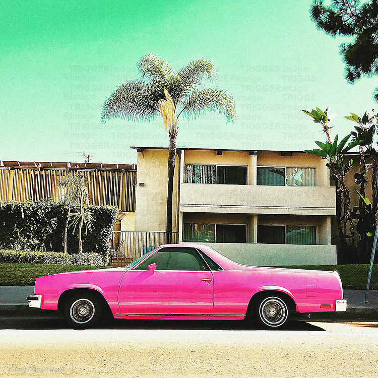 Vintage americana 60's car on street with palm tree