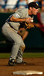 06/19/2006 Rice University's Greg Buchanan can't handle a ground ball in the third inning during game eight of the College World Series in Omaha Nebraska Monday evening..(photo by Chris Machian/Prairie Pixel Group)