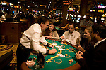 Blackjack table in Las Vegas Nevada, Caesars Palace and Casino, gaming, gambling, chips, blackjack, betting croupier, blackjack players, model released, blackjack table, cards, NV, Las Vegas, Photo nv234-18312..Copyright: Lee Foster, www.fostertravel.com, 510-549-2202,lee@fostertravel.com