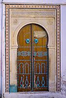 "Ceramics, Nabeul, Tunisia.  Tile Frame Around Door.  Tiles are of the ""Lion's Paw"" Design."