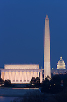 The Lincoln Memorial, Washington Monument, and US Capitol building in the twilight hour after sunset as seen from Arlington, Virginia