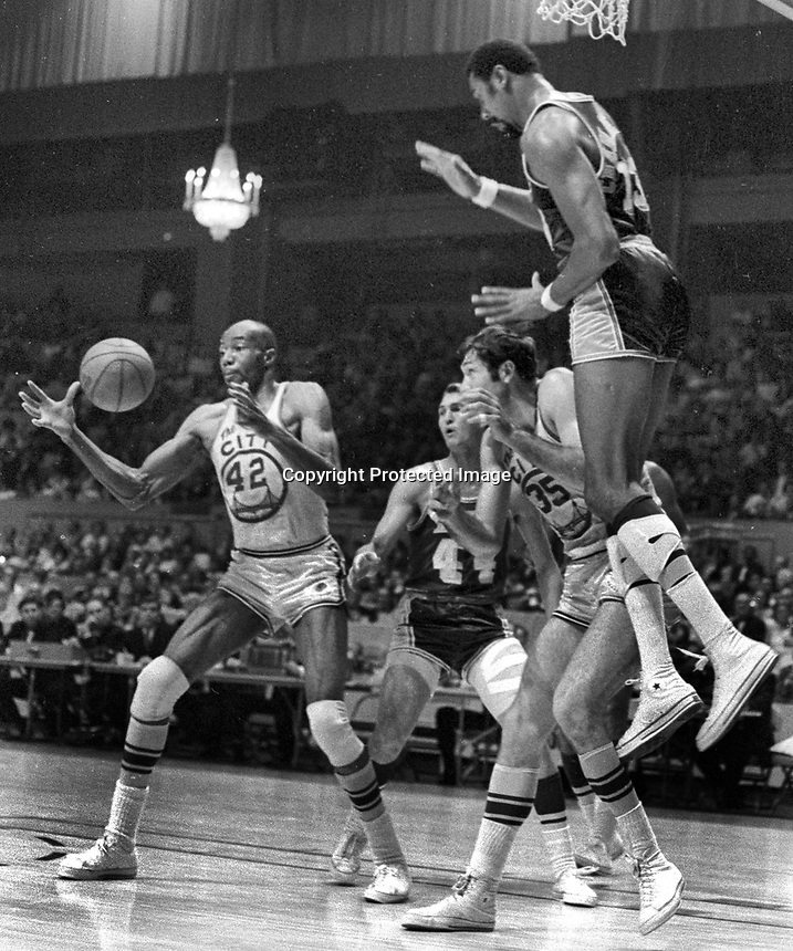 San Francisco Warriors vs the Los Angles Lakers 1965..Nate Thurmond, Jerry West, Jeff Mullins, and Wilt Chamberlain. (photo/ 1965 Ron Riesterer)