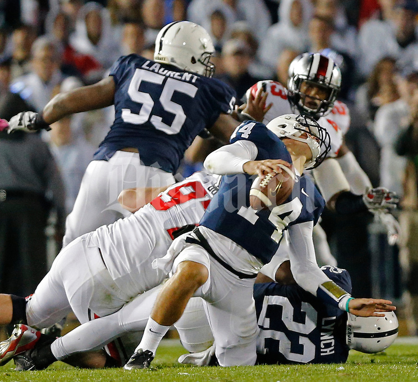 Ohio State Buckeyes defensive lineman Joey Bosa (97) sacks Penn State Nittany Lions quarterback Christian Hackenberg (14) in the second overtime of their game at Beaver Stadium in State College, PA on October 25, 2014. (Columbus Dispatch photo by Brooke LaValley)