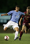 David Boole (17), of UNC, takes a shot after getting past Elon's Eric Sass (16) on Tuesday October 4th, 2005 at Fetzer Field on the campus of the University of North Carolina Chapel Hill in Chapel Hill, North Carolina. The UNC Tarheels defeated the Elon University Phoenix 2-1 after overtime in an NCAA Division I Men's Soccer game.