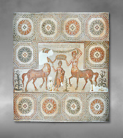 4th century Roman mosaic panel of the Goddess Venus from Ulules (Elles), Tunisia. Venus of Aphrodite is accompanied by 2 female centaurs, half women half horse creatures, known as Am(azoniu) and Titonius. The are crowning Venus The Bardo Museum, Tunis, Tunisia. The Bardo Museum, Tunis, Tunisia Grey background