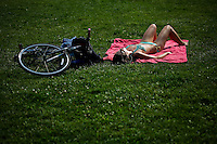 A woman takes a sun bath at the hoboken area during a heat advisory around New York, July 17, 2012. The National Weather Service predicts highs around 95 on Tuesday, Local Media reported.  Eduardo Munoz Alvarez / VIEW.