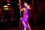 Sex worker Mila Moore works the pole in the parlor of the Moonlite Bunny Ranch brothel in Mound House, NV on Saturday, July 28, 2006...The Moonlite Bunny Ranch brothel in Mound House, Nevada - just a few miles from the state capital in Carson City - first opened in 1955. The Ranch is a legal, licensed brothel owned by Dennis Hof. It's featured in the HBO series &quot;Cathouse.&quot;