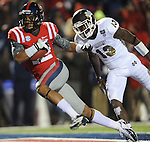 Mississippi wide receiver Donte Moncrief (12) scores as Mississippi State defensive back Johnthan Banks (13) defends at Vaught Hemingway Stadium in Oxford, Miss. on Saturday, November 24, 2012. Mississippi won 41-24. Moncrief scored three touchdowns on the night. (AP Photo/Oxford Eagle, Bruce Newman).