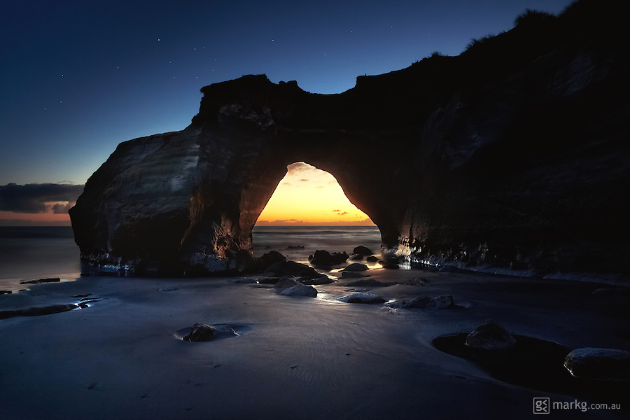 Twilight at the Hole in the Rock, Waverly, on the North Island of New Zealand. Unfortunatey, this iconic rock was destroyed by rough seas in 2013.