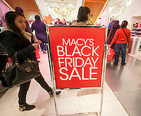 "A sign promotes Black Friday in the Macy's Herald Square flagship store in New York looking for bargains on the day after Thanksgiving, Black Friday, November 28, 2014. Many retailers, including Macy's, opened their doors on Thanksgiving evening extending the shopping day and giving Thanksgiving the nickname ""Gray Thursday"". (© Richard B. Levine)"