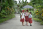 "Three girls walk to school in Tugala, a village on the Indonesian island of Nias. The village was struck by both a 2004 tsunami and a 2005 earthquake, leaving houses destroyed and lives disrupted. The ACT Alliance helped villagers here to construct new homes and latrines, build a potable water system, open a clinic and schools and get their lives going once again. For the residents of Tugala, the post-disaster mantra of ""build back better"" became a reality with help from the ACT Alliance."