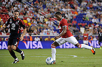 Patrice Evra (3) of Manchester United is defended by Heath Pearce (3) of the MLS All-Stars. Manchester United defeated the MLS All-Stars 4-0 during the MLS ALL-Star game at Red Bull Arena in Harrison, NJ, on July 27, 2011.