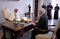 Pope Francis welcomes the President of Singapore, Tony Tan Keng Yam during a private audience on May 28, 2016 at the Vatican.