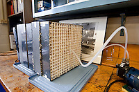 An air capture media in brush form is tested in the laboratory at the Lenfest Center for Sustainable Energy at the Earth Institute, at Columbia University in New York, USA, 10 November 2009.