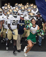Notre Dame head coach Brian Kelly (center) takes the field. The Notre Dame Fighting Irish defeated the Pitt Panthers 15-12 at Heinz field in Pittsburgh, Pennsylvania on September 24, 2011.