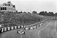 HAMPTON, GA - APRIL 22: Bobby Unser (#12 Penske/Cosworth TC) leads a group of cars during the Gould Twin Dixie 125 event on April 22, 1979, at Atlanta International Raceway near Hampton, Georgia.